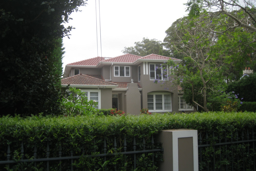 A home surrounded by trees and plants outside