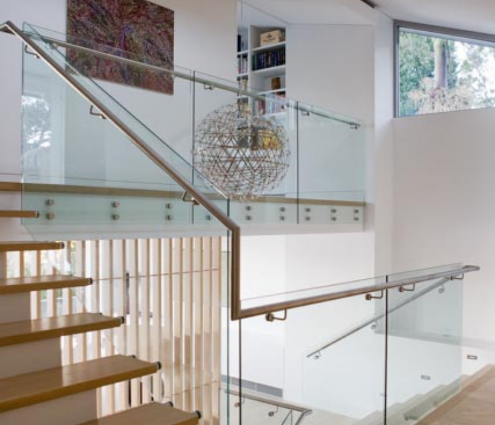 Wooden stairs and glass rail